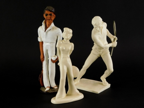 Three tennis player caricatures, to include a Chelsea pottery Studioware figure of a tennis player, 26cm high, an Art Deco figure stamped Gouda, (AF), and a white resin figure of tennis player. (3)