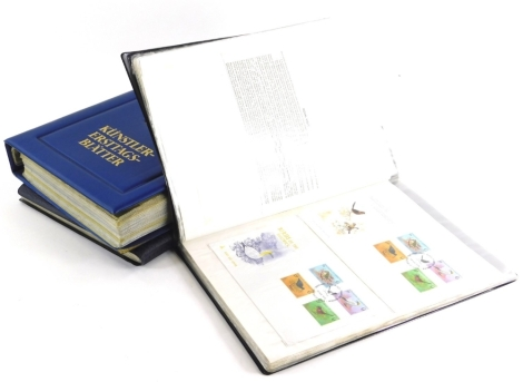 Three albums containing First Day covers, etc.