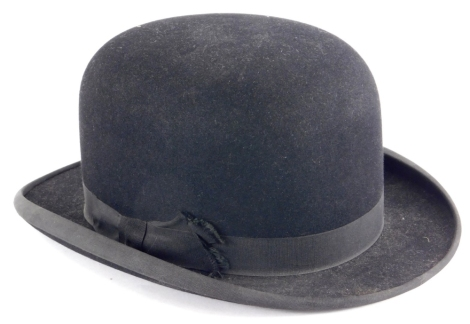 A Dunn and Co bowler hat, label to inside, numbered 400, 758.