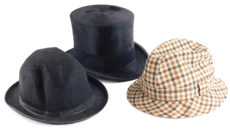 A Tress and Co London top hat, a tweed hat and a dress hat.