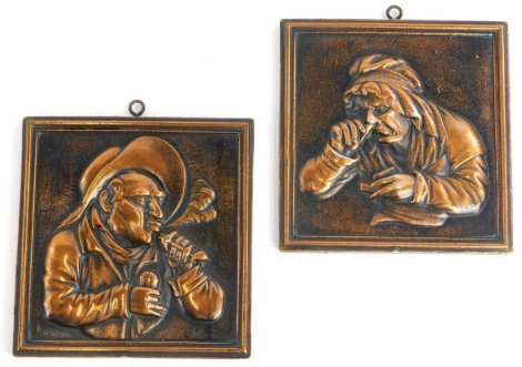 A pair of cast copper panels, each decorated with figures in Dutch style, 15cm x 14cm.