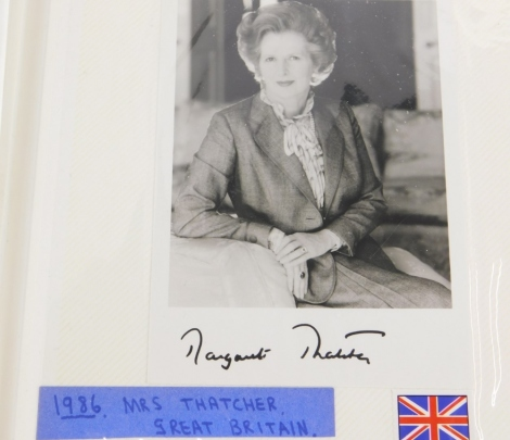An album containing political photographs, to include some bearing the signatures of Margaret Thatcher, Ronald Reagan, A Helmet Kohl, Rajiv Gandhi, and a large number of world politicians, mainly facsimile.