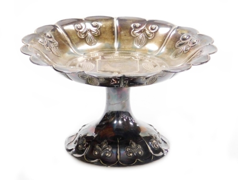 A George V silver sweet meat dish, with fluted body with raised embossed detailing, maker J D and S, London 1931, 10cm high, 12½oz of weighted silver.