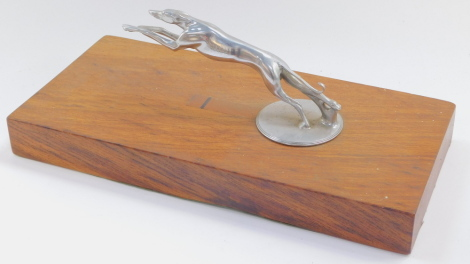 A Lincoln greyhound radiator cap mascot, c1930's, raised on a wooden base, 22cm wide.