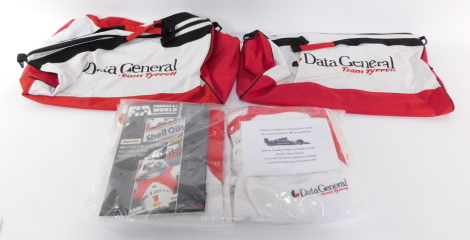 Two team Tyrrell sweatshirts and two holdalls, sponsored by Data General, for the Silverstone Grand Prix 1987 Tyrrell DG016, cars driven by Jonathan Palmer and Philipp Streiff, together with a Silverstone Grand Prix programme 10-12 July 1987. (5)