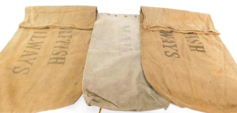 Two Royal Railways jute mail sacks, 70cm high, 120cm wide, and a US Mail sack, no 2, 3-63, 60cm high, 90cm wide. (3)