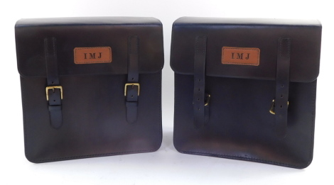 A pair of black leather motorcycle panniers.