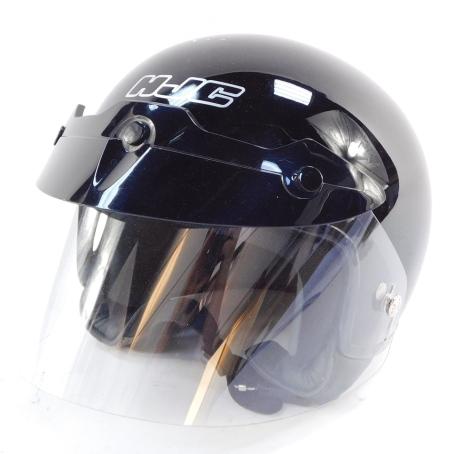 An HJC black motorcycle helmet Fl-22, with flip up visor, 65/8 / 6¾ inches.