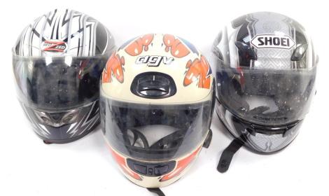 A Shoei XR1000 motorcycle helmet, AVG type A motorcycle helmet and a Red Zed RX-406 motorcycle helmet. (3)