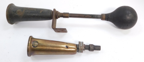 A Desmo car horn, together with a King of The Road car horn. (2)