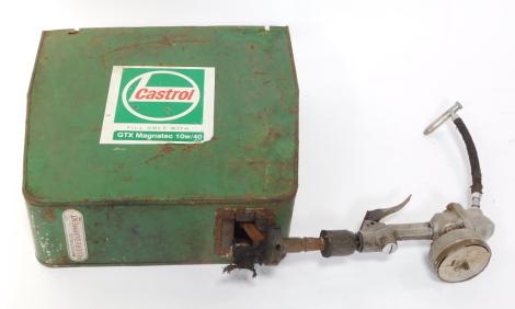 A Castrol Wakefield Lubrequipment garage oil dispenser.