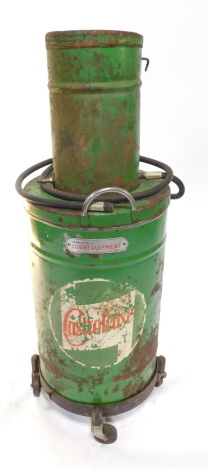 A Castrol Wakefield Lubrequipment garage oil dispenser, of cylindrical form, on wheels.