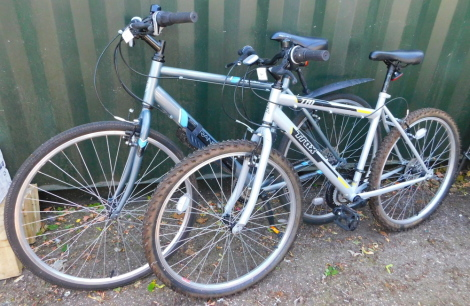 An Apollo Transfer Hybrid bicycle, together with a TRAX TR1 bicycle. (2)