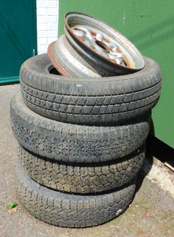 Three Serca wheels and four tyres.