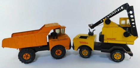 A Tonka model of a dump truck XMB975, together with a Tonka Toymaster model of a crane truck M970. (2)