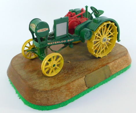 A die cast model of a Kerosene Tractors Waterloo Boy, trophy mounted on a wooden stand, with plaque engraved Burden Tractors Trophy Presented Annually For The Best Tractor On Show Manufactured Between 1951-1960.