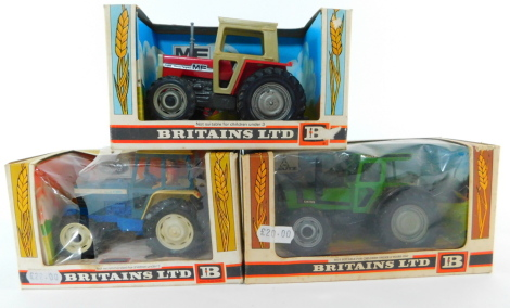 Three Britains die cast models of tractors, scale 1:32, comprising a Deutz tractor 9526., Massey Ferguson tractor 9522., and a Ford Tractor 9524, all boxed.