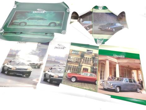Nine promotional Jaguar posters, two 70cm x 100cm, and seven 76cm x 51cm.