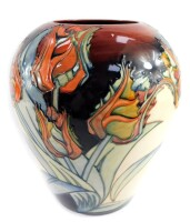 A Moorcroft pottery vase, decorated with flowers against a cream and red ground, painted and impressed marks, 30cm high.