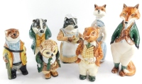 A set of seven Cinque Port pottery Rye Country Gentleman animal and bird figures, including Sir Freddy Fox., Mrs Fox., otter., owl., and two badger figures. (7)