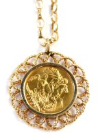 A George V full gold sovereign pendant and chain, dated 1913, in a floral design border, on a curb link 9ct gold chain, 66cm long, 20.2g.