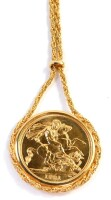 An Elizabeth II full gold sovereign pendant and chain, dated 1981, the pendant surround is the applied chain, with sliding clasp, on a fancy link chain, the necklace section 48cm long, 13.5g all in.