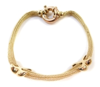A 9ct gold bracelet, of multi-link design, with cross design bordering (AF), with large circular loop clasp, 16cm long, 12.8g.