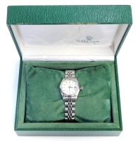 A Rolex Oyster Perpetual lady's wristwatch, in stainless steel case with silvered dial and raised date aperture, on a Rolex steel bracelet numbered 62510D and CL12, the lugs stamped 568B, with Rolex carry case box and guarantee, together with a receipt fr