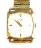 A Rotary 9ct gold cased gentleman's wristwatch, silvered dial with gold batons, 21 jeweled movement, the case of square form on an elasticated bracelet.