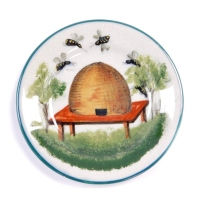A Wemyss late 19thC pottery tea plate, decorated with a beehive and bees, retailers mark for TG Goode and Company, South Audley St, London, painted and impressed marks, 14cm diameter.