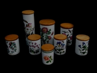 Eight Portmeirion pottery storage jars decorated in the Botanic Garden pattern, with wooden lids, some seconds, printed marks.