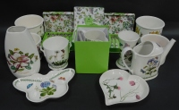 A group of Portmeirion pottery decorated in the Botanic Garden pattern, including four canape dishes, six teaspoons and pastry forks, and a pitcher, all boxed, vases and jardinieres, watering can and shaped dishes. (a quantity)