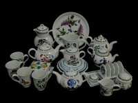 A group of Portmeirion teawares decorated in the Botanic Garden pattern, including teapots, covered hot water jug, pitcher, milk jugs, toast rack, cake and bread plates. (a quantity)