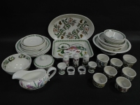 A group of Portmeirion pottery decorated in the Botanic Garden pattern, including a lasagne dish, oval dish, condiments, ramekins, cress dish, and a salad bowl, together with a sauce boat decorated in the Ladies Flower Garden pattern 1994. (a quantity)