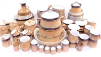 A Denby brown pottery dinner tea and coffee service, including vegetable tureen and covers, dinner plates, steak plates, fruit bowls, cups, saucers, tea plates, egg cups, etc. (a quantity)