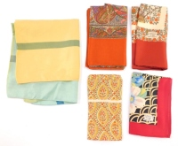 Five Liberty and Co silk scarves, variously decorated.