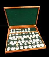 A Birmingham Mint part medal set of Great British Regiments, 33 medals with associated cap badges, set number 1572, cased.