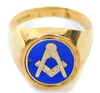 A 9ct gold Masonic gentleman's signet ring, the oval panel set with blue enamelling and Masonic symbol (AF) with reeded interior and a back crest bearing initials MV, ring size N, 5.2g all in.