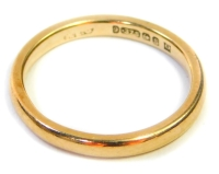 A 9ct gold wedding band, of thin design, ring size J½, 1.9g.