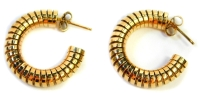 A pair of 9ct gold hoop earrings, each of layered design of single pin back with butterfly back, makers stamp DJ, Birmingham, 10.4g all in.