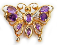 A 9ct gold butterfly brooch, set with two tiny diamonds and various amethysts, 2.5cm wide, 2.9g all in.