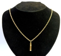 A 9ct gold pendant and chain, the pendant of rectangular design, with various twist panels, floral engraved, on a fancy link chain, the pendant 2cm high, the chain 45cm long, 12.1g all in.