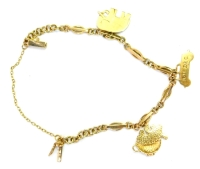 A 9ct gold charm bracelet, of fancy link design with three 9ct gold charms, to include a car dated 16th December, a bear in a cup, and an elephant bearing the name Christine, approx 13cm long, 7.4g.