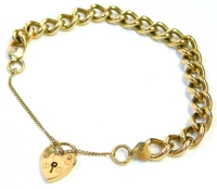 A 9ct gold charm bracelet, the heavy curb link bracelet with a heart shaped padlock and safety chain, the bracelet 18cm long, 34g.