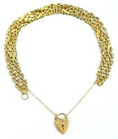 A gate bracelet, the chain of multi layered link design, with central diamond shaped bordering, with a safety chain and heart shaped clasp, yellow yellow metal stamped 375, 18cm long, 7.3g.