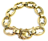 A 9ct gold fancy link bracelet, with large oval cut out links joined by curb links, with safety chain, 18cm long, 16.4g.