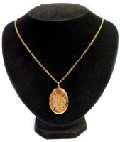 A 9ct gold oval portrait locket, with hammered floral decoration, on a 9ct gold curb link chain, the locket 3.5cm high, the chain 52cm long, 15.8g all in.