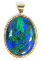 A oval stone set pendant, the green and blue oval stone in a rope twist rub over yellow metal border, unmarked, 5.5cm high, 3.5cm wide.