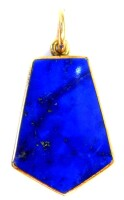 A 9ct gold pendant, the pentagonalshaped pendant set with lapis lazuli and black polished stone, with single loop clasp, 3cm high, 2.9g all in.