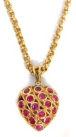 A 9ct gold heart shaped pendant and chain, the open work design heart pendant set with rubies to one side and sapphires to the reverse, on a belcherchain, the pendant 1.5cm high, the chain 38cm long, 8g.